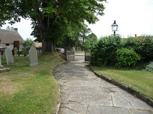 The churchyard pathway at Curry Rivel, Somerset, leads out onto the Green