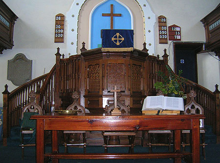 Pulpit in Dursley Tabernacle showing the monument to John & Susanna Dando on the left